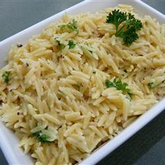 Parmesan Garlic Orzo ~ Cook 1 cup orzo in salted water; drain. Melt 1/4 cup butter in a skillet over medium heat; cook & stir 2 tsp minced garlic until lightly browned, about 5 minutes. Stir cooked orzo into garlic mixture & mix in 1/4 cup Parmesan cheese, 2 Tbsp milk, 1 Tbsp chopped fresh parsley, salt and black pepper to taste. #pasta