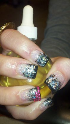 Black & silver acrylic nails with pink bling!