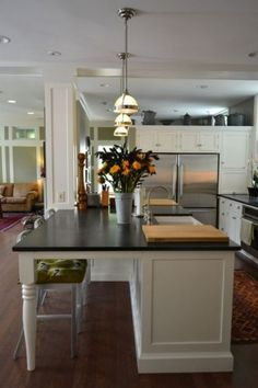 liking the design of this #kitchen island -- traditional kitchen by Colleen Steixner