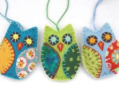 Colorful owl Christmas ornaments, handmade from felt and cotton prints with hand…