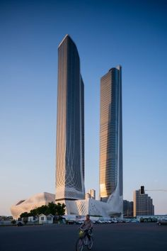 The tallest of the towers in Zaha Hadid Architect's Nanjing complex is 314 metres, and will contain offices and a five-star hotel across its 68 storeys. The shorter one measures 255 metres in height.