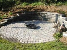 Will our retaining wall slope down like this? Cutting into the hillside made room for this patio and fire pit . Fire Pit Area, Diy Fire Pit, Fire Pit Backyard, Backyard Patio, Fire Pits, Fire Pit Wall, Fire Pit On A Slope, Fire Pit Landscaping, Hillside Landscaping