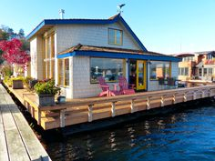 How cool would it be to live in a floating house and have a wrap-around deck? No lawn to mow and beautiful views.