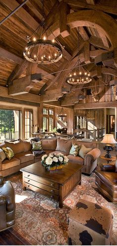 Bellegrey, LLC | Rustic Living Room Design layout is great. walk into great room dining area   on the right ,kitchen on left, living room as seen