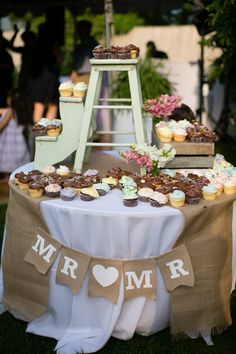 What a find, this step ladder to display Magnolia Bakery Cupcakes.    Flowers by Chicory Florals, Philadelphia