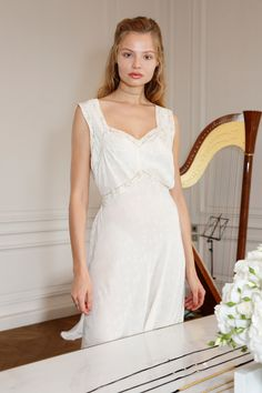 5 July Magdalena Frackowiak wore a simple white dress to the launch of her latest jewellery collection in Paris.   - HarpersBAZAAR.co.uk