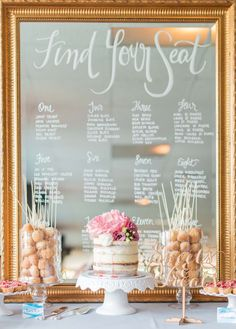 Lovely mirror seating chart framed by sweets.