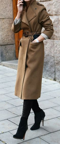 Camel coat tied with a leopard belt