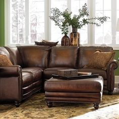 Beautiful modern sectional with antique inspired leather.