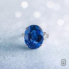 Harry Winston Oval Sapphire Ring features a vibrant 24.66-carat center stone.