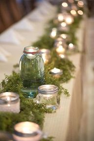 Mason jars, candles and moss table decor