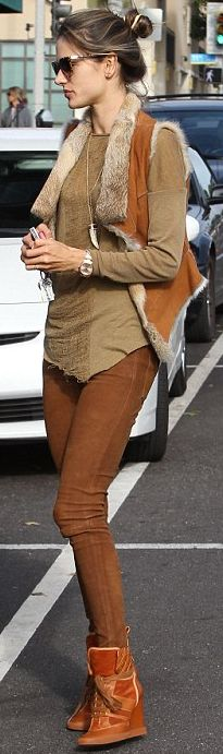 Who made Alessandra Ambrosio's brown skinny jeans, jewelry, brown long sleeve top, and brown wedge sneakers that she wore in Santa Monica?