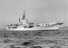 HMS Theseus (R64) Colossus-class light fleet aircraft carrier of the British Royal Navy. Circa. 1950's. (google.image) 8.17