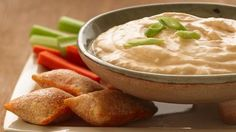 Buffalo Cheese Dip ~ Recipe: 8 oz. softened Cream Cheese, 2/3 c. Chunky Blue Cheese Dressing, 1-2 T. Buffalo Wing Sauce, sliced Green Onions (optional). In microwavable bowl, mix cream cheese, dressing & wing sauce until smooth. Coverm microwave on High 2-3 min. or until hot. Sprinkle with green onions. Great with veges & chicken drummies.