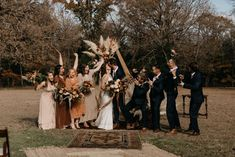 Wedding party cheering on the bride and groom for a kiss at the altar | Image by Marissa Merrill Photography