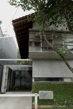 """Built by SUB. Studio for visionary design in Jakarta Capital Region, Indonesia with surface Images by Dean Martin. This project shows Indonesian house in SUB. it calls """"D-minution House"""". Intended to reach affordable . Modern Tropical House, Tropical Houses, Tropical Design, D House, Facade House, House Party, Modern Exterior, Exterior Design, Indonesian House"""