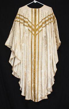 http://www.ebay.com/itm/Vintage-White-Brocade-Chasuble-ANGELS-Gloria-Priest-Vestments-Church-Clergy-/162080761222?hash=item25bcc42586:g:QtMAAOSwSWJXQxrS