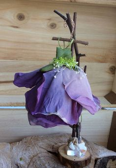 Dress Found in the Garden... 3 Inch Dress ~ Lovely Silk Floral Gown with Babys Breath and Moss Sash. Handmade Hanger and Branch Stand with Pearl Shell and Moss base. This is an art piece to add to your Fairy Garden... Handcrafted Dress ~ 3 Inches (neckline to skirt end_