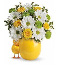 This adorable bouquet will brighten any room with its beautiful blooms. Moms love the ceramic chick. White daisies, yellow roses and green button spray chrysanthemums.