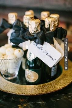 So cool! - Mini champagne bottle favors | CHECK OUT MORE GREAT BLACK AND WHITE WEDDING IDEAS AT WEDDINGPINS.NET
