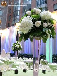 white and green flowers wedding reception theme