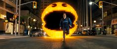 Pac-Man chases Ludlow (Josh Gad) in Columbia Pictures' PIXELS. Courtesy of Columbia Picture http://www.thevideographyblog.com/share/pixels-3/?share_image=http%3A%2F%2Fd3l9bzfuzkm13y.cloudfront.net%2Fwp-content%2Fuploads%2F2015%2F08%2Fpixels-dom-PK-13_PM_1610_comp_v0157-1053_r-1310x554.jpg © 2015 CTMG, Inc. All Rights Reserved.