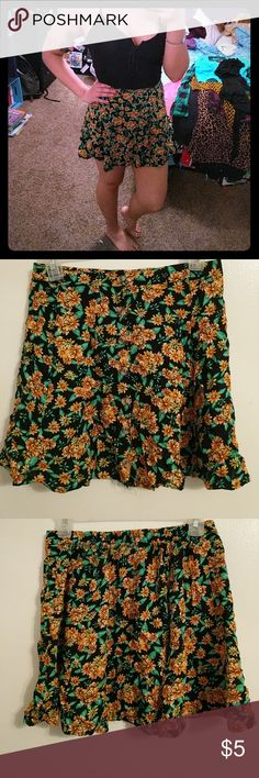 Flower print high waisted circle skirt Never been worn. Buttons up in the front. LA Hearts Skirts Mini