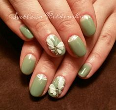 Simple but gorgeous looking butterfly nail art design. The olive themed nail art works perfectly with the white theme of the lace designs as well as the white butterfly embellishment on top.