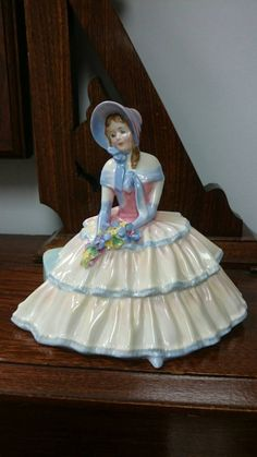 Here we have a beautiful Royal Doulton figurine. This one is named Daydreams (HN1731) and stands 6 tall. It is in excellent condition with no