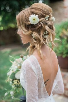 Love this messy up do with flowers.  Perfect for an outdoor ceremony. www.agaveofsedona.com