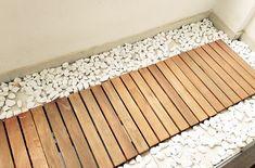 Instalando o deck e as pedras na varanda