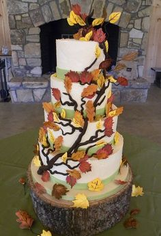 Five tier white tree theme wedding cake with branches and leaves and tree trunk.JPG