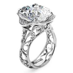 Style R2784, 18k white gold and diamond ring with oval-cut center stone, Parade