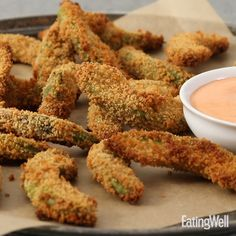 Creamy avocados are a delicious foil to crunchy breading in this healthy oven-fried avocado fries recipe. Dip into spicy Sriracha dipping sauce for a flavor explosion. Save your ripe avocados for guacamole or toast—only firm ones will do when making these Health Appetizers, Vegan Appetizers, Appetizer Recipes, Health Desserts, Avocado Recipes, Healthy Recipes, Avocado Dishes, Aperitivos Vegan, Skinny Recipes