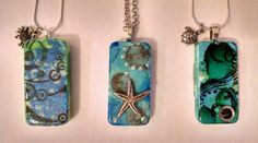 Check out this item in my Etsy shop https://www.etsy.com/listing/476766601/ocean-necklaces-domino-necklaces-altered