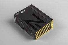Black block foiled corporate handbook designed by Maud for The National Institute of Dramatic Art