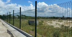 Green low Security clear view fence with line wire topping is used for road fencing, separating the road from grassland.