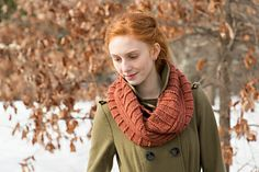 A textured infinity scarf to be worn doubled or single.