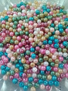 Check out this item in my Etsy shop https://www.etsy.com/listing/253381847/glass-pearls-4mm-cool-multi-tone-60