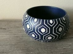 LOVE these hand painted bracelets.  blue and white wooden bracelet by Aramar on Etsy, $18.00