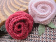 These beautiful, felted wool flowers are made from up-cycled sweater scraps. The flowers are hand-stitched to give a realistic rose appearance.