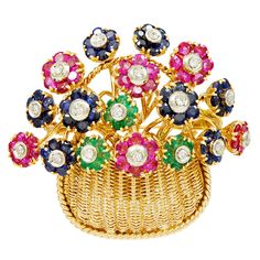 Gorgeous 18K gold Flower Basket by Tiffany & Co. En Trembant flowers set with Rubies, Sapphires and Emeralds, centered with Diamonds.Circa 1950s