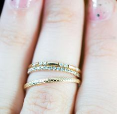 The Constellation bandis hand set with fourteenCanadian diamonds unexpectedly scattered around a 1.5mm recycled 14k gold band. It has a night sky quality of s
