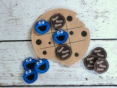 Cookie Monster Tic Tac Toe ITH Embroidery Design    This design is done in the 5x7 hoop. Includes TTT Board, Nom Nom Nom and Cookie Face piece.