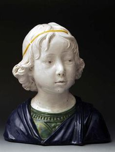 A Cantagalli maiolica bust, head and shoulders, of a young boy wearing a green top and blue wrap,