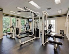 Traditional Home Gym with Concrete floors, Crown molding, French doors, flush light