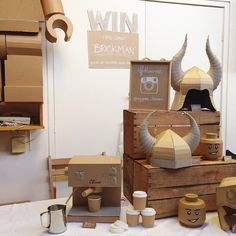 Cardboard stall with cardboard Viking helmets, legohead money boxes and cappuccino machines. Zygote Brown Designs