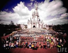 Group portrait of entire Walt Disney World staff, including cast of costumed Disney characters in fore, standing in front of Cinderella Castle prior to grand opening of amusement park. Description from pinterest.com. I searched for this on bing.com/images