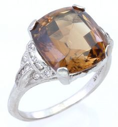 Art Deco chrysoberyl and diamond ring in pt. Square cushion-cut brownish chrysoberyl, approx. 6.15 ct.