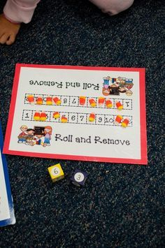 Great math tub activity ~ I think I'd use a Hundreds chart and have my kids add the sum of the dice and then remove the candy corn.